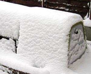 An Eglu Go hutch covered in snow